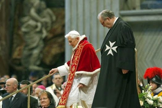 Prince and 79th Grand Master of the Order of Malta, Father Matthew Festing stands near Pope Benedict XVI during a mass given to mark the 900th anniversary of the official recognition of the Order of Malta by Pope Pascal II